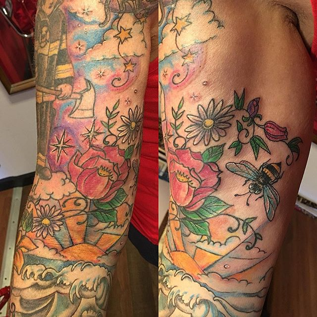 Bee and background today #beetattoo #tattooedlady #colortattoo #flowertattoo #colorful #ouch
