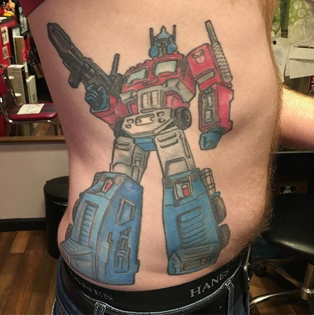 Healed a few years #optimusprimetattoo #transformers #sidetattoo #healedtattoos #tattoobliss