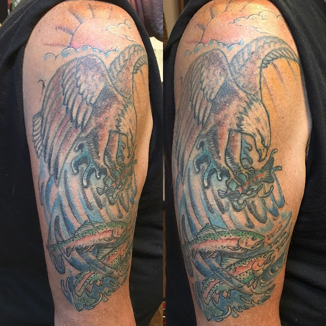 Healed nice! Eagle was old and we fixed him up plus added the new fish #trouttattoo #eagletattoos #fishingtattoo #naturetattoo #healedtattoo #blendtattoo #addontattoos #redotattoos #20yearslater #tattoobliss