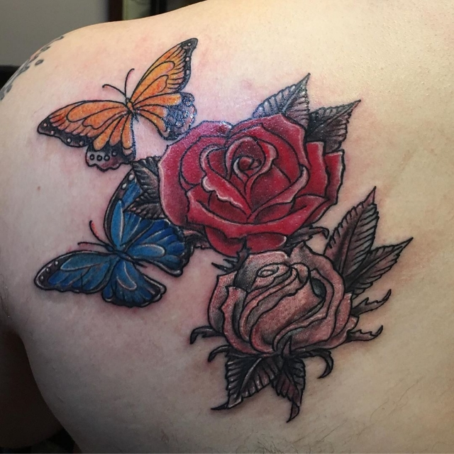 Based on his Mom's tattoo #rosetattoos #shouldertat #butterflytattoos #momtattoos #tattooedguys #matchingtattoos #freshtattoo #tattoobliss